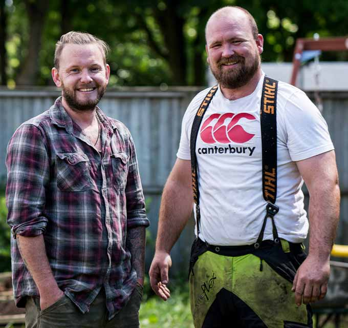 Tree surgeons paused at work to smile at the camera
